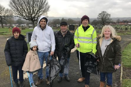 Clean-up:  MP Mark Eastwood with members of the New Friends of Dewsbury Cemetery during the litter-pick.