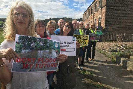Members of Granny Lane Area Action Group (GLAAG) by meadowland in Hopton Bottom, near Mirfield, destined for housing