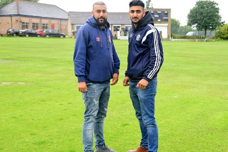East Bierley captain Raheel Ahmed and Batley counterpart Roheil Hussain survey the scene at a wet Mount Pleasant on a day when they entire Bradford League programme was abandoned. Picture Paul Butterfield