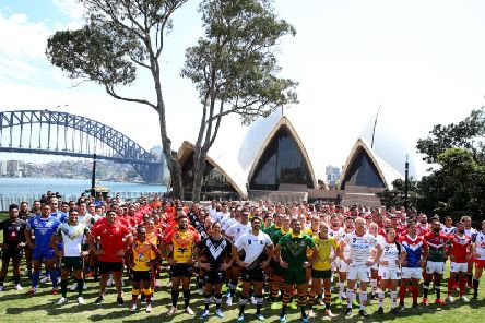 The competing nations pose for a group photo during the Rugby League World Nines media day at the Royal Botanic Gardens
