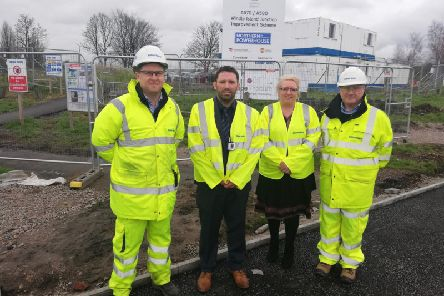 Councillor Lynn Clarke (second on right) and St Helens Council's Engineering Service Manager, Steve Walker (second on left) visited Windle Island to get an update on the soon to be completed junction improvement scheme.