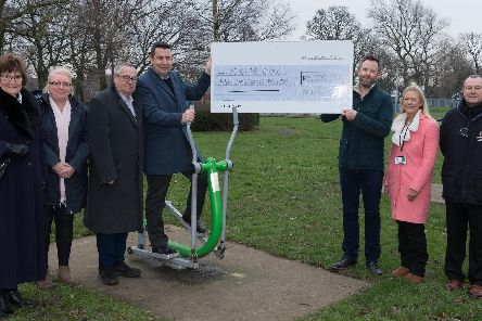 Jamie Leason (third on right) from Fields in Trust visited St Helens to present the council with a cheque for 5,000 which will be used to deliver sports activities in Sutton Park. Also pictured: local ward councillors Jimmy and Pat Jackson; St Helens Council's portfolio holder for parks and open spaces, Coun Lynn Clarke (second on left); St Helens Council's portfolio holder for leisure services, Coun Anthony Burns (fourth on left); and St Helens Council Sports Development staff, Gemma Harkness (second on right) and Terry Bates (end right).