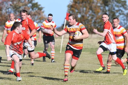 Seaham RFC (red) v Richmondshire RFC (hoops) at Seaham park, on Saturday.