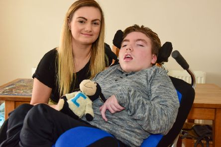 Craig Rennoldson, from Seaham, with sister Anna Henry, who together with the rest of the family are trying to raise �25,000 to build a ground floor extention, to save Craig's parents having to carry him upstairs.