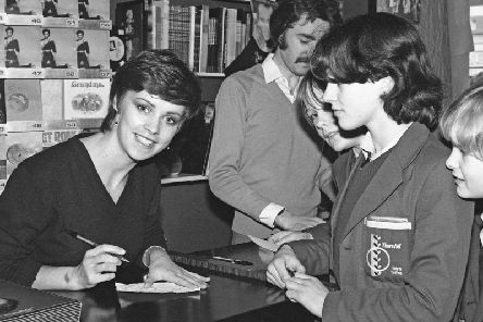 Pop star Sheen Easton signs autographs for young customers at Sunderland's former HMV store in 1981.