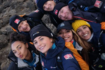Members of Team Kilimanjaro pose for a selfie as the going gets even tougher on their climb for Comic Relief. Pic: Chris Jackson/Getty Images.