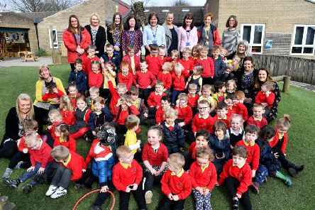Julie Heron (rear centre) Headteacher of Oxclose Community Nursery School with staff and pupils. Picture by FRANK REID