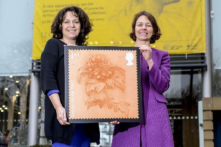 Rebecca Ball, Creative Director of Sunderland Culture and (R) Julie Elliott MP for Sunderland Central hold an enlarged print of the Leonardo Da Vinci postal stamp which is being exhibited at Sunderland Museum and Winter Gardens