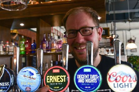 Steve Smith proudly displays the new Vaux beer pump clips