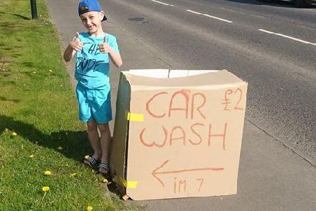 Ashton Murray has set up his own car wash to raise funds.