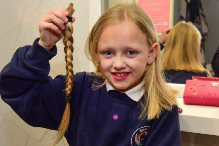 Macie-lee Layton, seven, had her long hair cut off for charity.