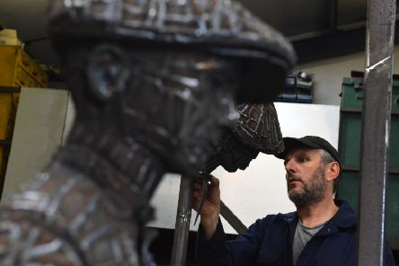 Ray Lonsdale pictured as he worked on the sculpture.
