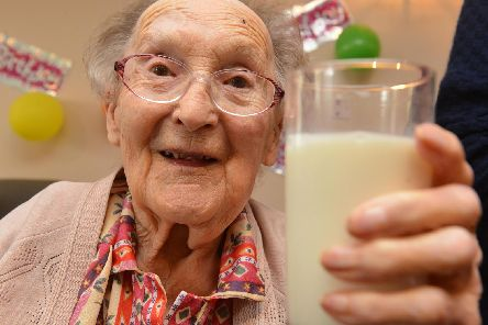 Elsie Proud celebrates her 101st birthday with a glass of milk for memories from when she used to milk the cows on her family farm