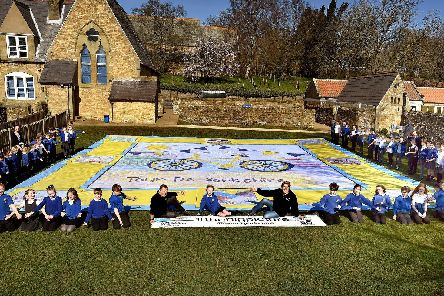 Libby Graham and the other pupils at Wykeham School at the Tour de Yorkshire land art reveal. Picture: Richard Ponter