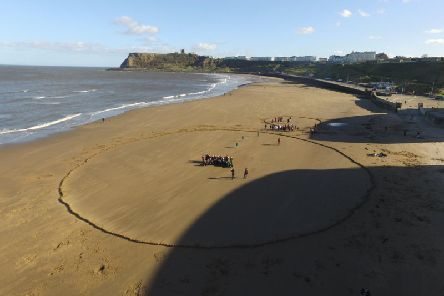 School children built more than 800 sandcastles as part of an event to celebrate Pi Day.