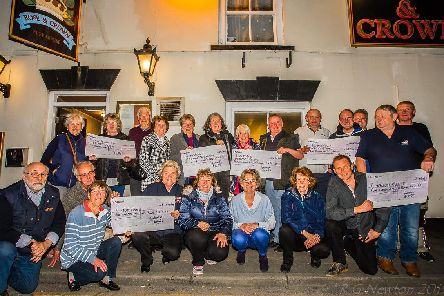 The Flamborough Fire Festival team hand over cash