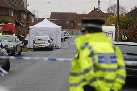 Police are looking to pay people to guard crime scenes (file photo)
