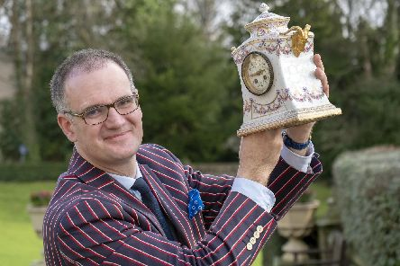 Antiques expert Charles Hanson with a Sevres Porcelain Mantel Clock c1900 at a charity event at Kenwood Hall. Picture Scott Merrylees