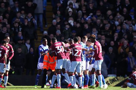 A fan attacks Aston Villa's Jack Grealish on the pitch (right) during the Sky Bet Championship match at St Andrew's Trillion Trophy Stadium, Birmingham.