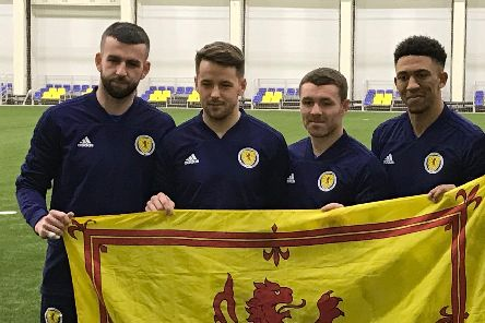 Four of the five players looking to win their first Scotland caps (from left to right) Liam Kelly, Marc McNulty, John Fleck and Liam Palmer. Gavin McCafferty/PA Wire.
