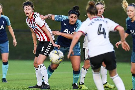Dan Cox of Sheffield Utd and Renee Hector of Tottenham watch as the ball goes loose in the box: Harry Marshall/Sportimage