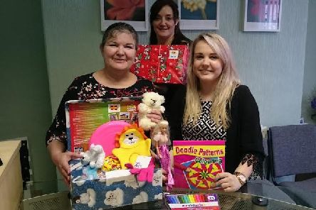 Jan Copestake, Jill Sanctuary and Becky Hulme from Baines Bagguley Penhale with some of the donated shoeboxes.