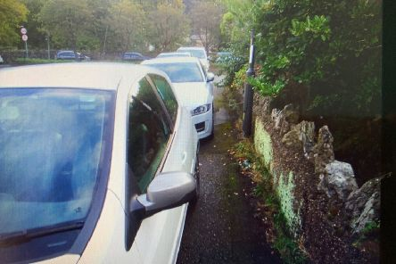 Cars parked on the pavements on Greaves Drive are blocking access for people with wheelchairs and prams.