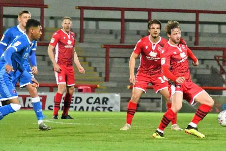 Andrew Tutte was one of Morecambe's scorers as Derek Adams' first game in charge brought EFL Trophy victory against Carlisle United