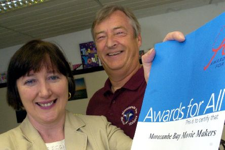 """Geraldine Smith MP presents a National lottery """"Awards for All"""" grant worth �4676 to Graeme Isherwood acting chairman of Morecambe Bay Movie Makers."""