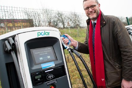 Lancaster City Coun John Reynolds at the new electric vehicle charging hub in Lancaster