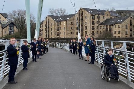 Pupils from Our Lady's Catholic College celebrated Random Acts of Kindness Day by handing out flowers to members of the public on Millennium Bridge.