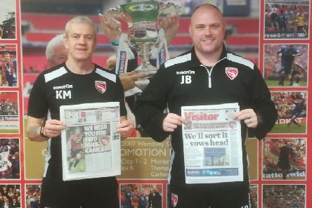 Morecambe boss Jim Bentley, right, and his assistant Ken McKenna with copies of this week's Visitor.