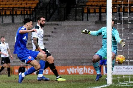 Aaron Collins has scored winners at Port Vale (above) and Oldham Athletic within the last week for Morecambe