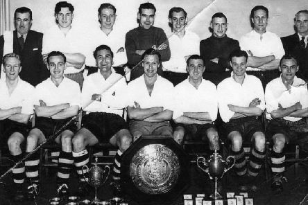 Bentham United 1953-54'Back row from left: - Ernie Maunders (Trainer), Frank Wheildon, Ted Bolton, Alan Fox, Jack Bowery, George Downham, Bill Noble, Storey Batty (Committee)'Front row from left: - Des Churchman, Tommy Chappell, Frank Ashworth, John Glaister (Capt.), Bill Mashiter, Bobby Holt, and Johnny Worden.