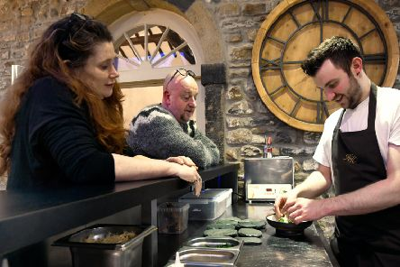 Siobhan and Martin Miles-Moore working on new ideas at Hipping Hall with chef Olli Martin.