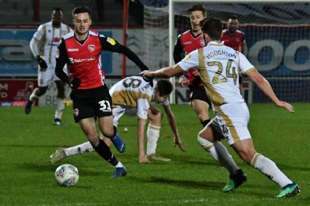 Aaron Collins seeks his fifth goal since joining Morecambe last month when they go to Swindon Town on Saturday