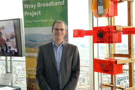 Prof Nick Race alongside the digital scarecrow at the BT Tower in London