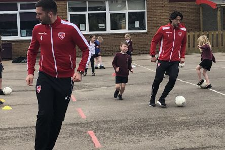 Morecambe duo Alex Kenyon and Zak Mills have joined school PE lessons