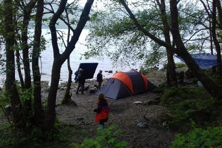 Building the camp on the beach at Loch Lomond