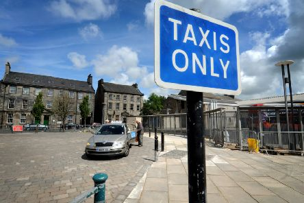 The taxi rank next to the bus station in Lancaster