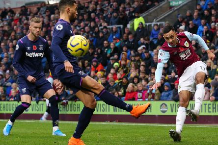 Burnley winger Dwight McNeil whips in a cross against West Ham United at Turf Moor