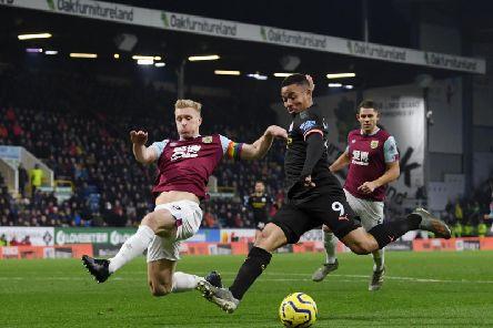 Burnley skipper Ben Mee prevents Manchester City's Gabriel Jesus from getting a shot in on goal at Turf Moor