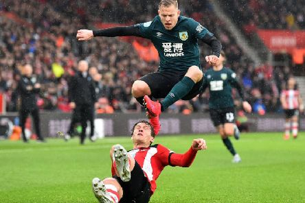 Burnley's Czech striker Matej Vydra (top) avoids Southampton's Danish defender Jannik Vestergaard during the English Premier League football match between Southampton and Burnley at St Mary's Stadium.