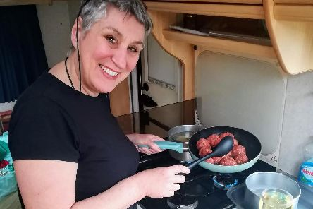 Karen whips up some meatballs in the caravan kitchen.