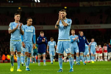 Leeds United players applaud the huge travelling support that roared them on against Arsenal. Picture: Bruce Rollinson