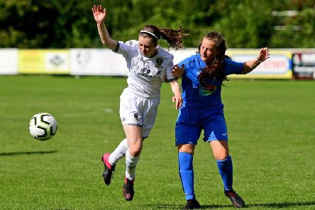 Leeds' Caitlin Gough battles for the ball in Sunday's match against Stockport County.