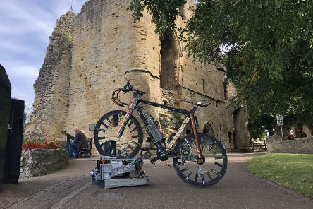 The bike, named Victoria Pedalton, is made from nearly 1,000 old computer parts and took 100 hours to make. (S)