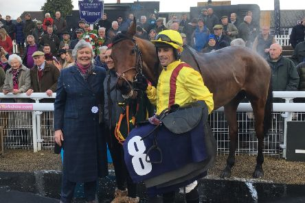 Cracking Find with owner Ann Ellis and jockey Sean Quinlan after their Castleford Chase triumph.