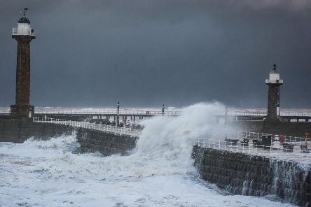Whitby piers take a battering. Picture by Ceri Oakes.
