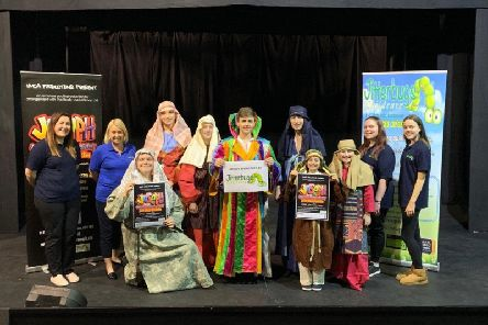 Linda Wood and the staff from Jitterbugs Childcare with cast members from YMCA Theatres Joseph and the Amazing Technicolor Dreamcoat.